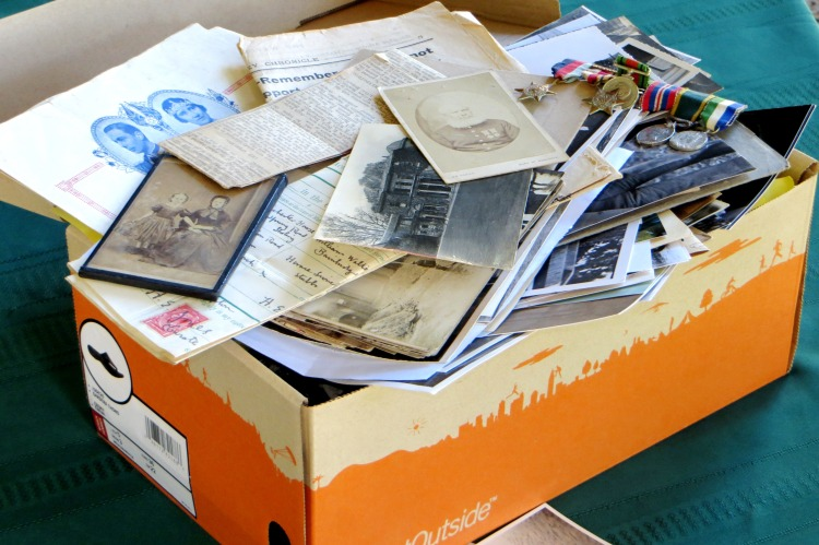 Shoebox full of photos and papers